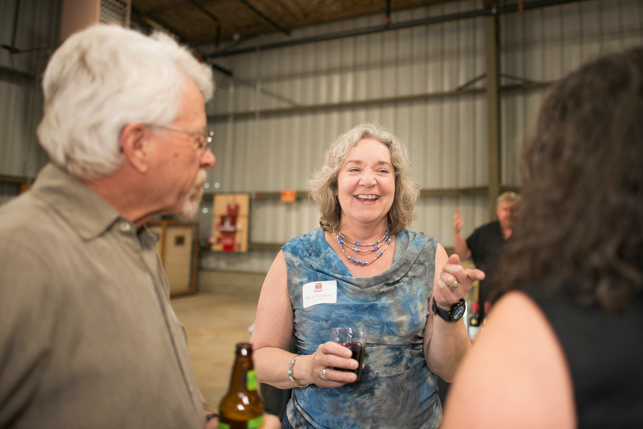 Darin Goodsell (center) enjoys a conversation at the Alumni Spring Barbecue that is held at the University Farm on Thursday, April 27, 2017, in Chico, Calif.  (Jessica Bartlett/ Photographer)