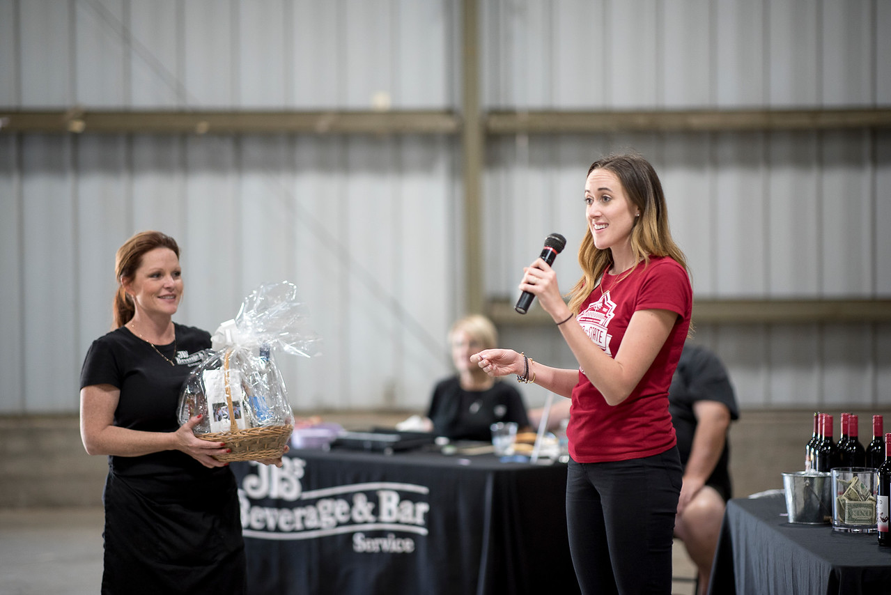 Kaitlin Tillett (right) draws the winning ticket to a raffle prize at the Alumni Spring Barbecue that is held at the University Farm on Thursday, April 27, 2017, in Chico, Calif.  (Jessica Bartlett/ Photographer)