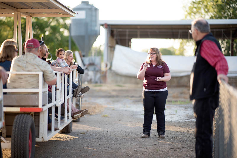 Sarah Deforest (center) provides a tour of the farm to the guests at the Alumni Spring Barbecue that is held at the University Farm on Thursday, April 27, 2017, in Chico, Calif.  (Jessica Bartlett/ Photographer)