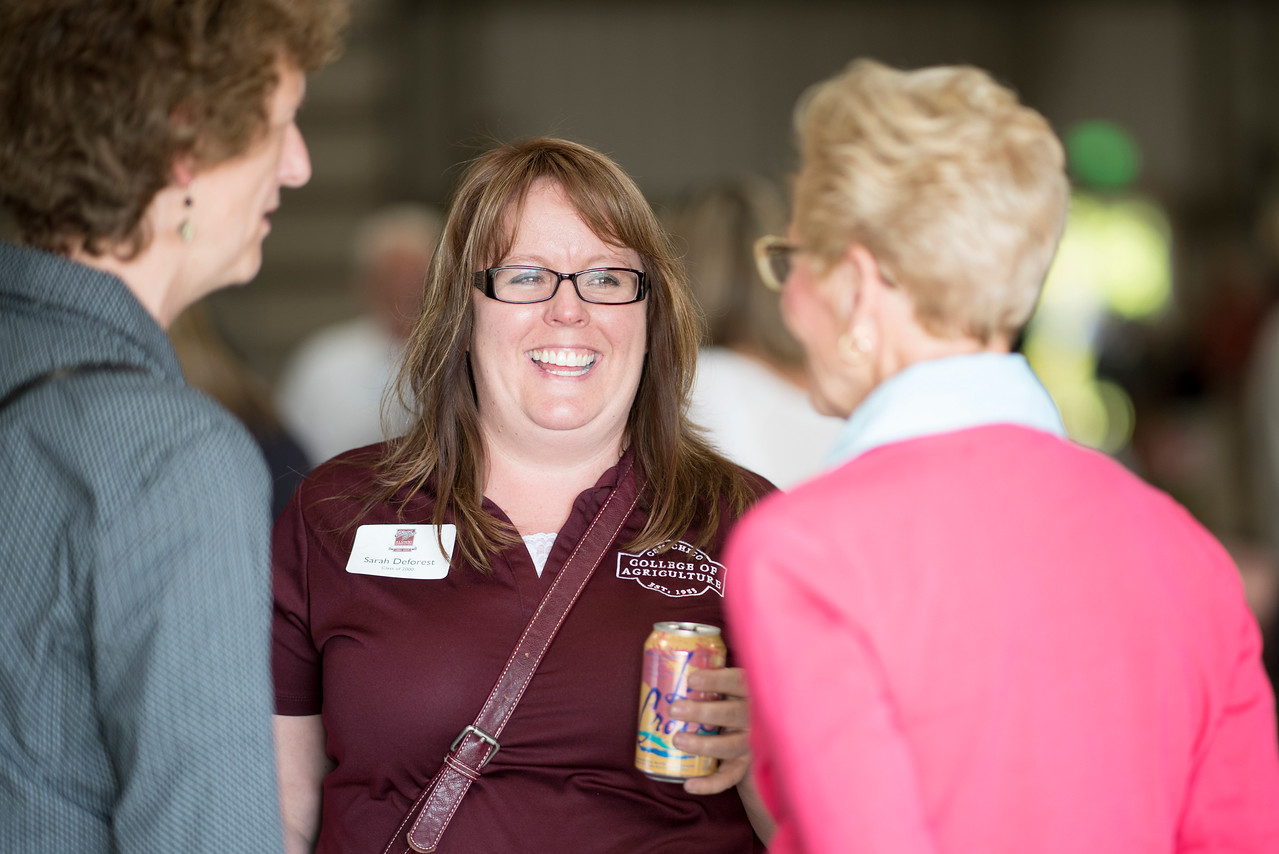 Sarah Deforest (center) enjoys the Alumni Spring Barbecue that is held at the University Farm on Thursday, April 27, 2017, in Chico, Calif.  (Jessica Bartlett/ Photographer)