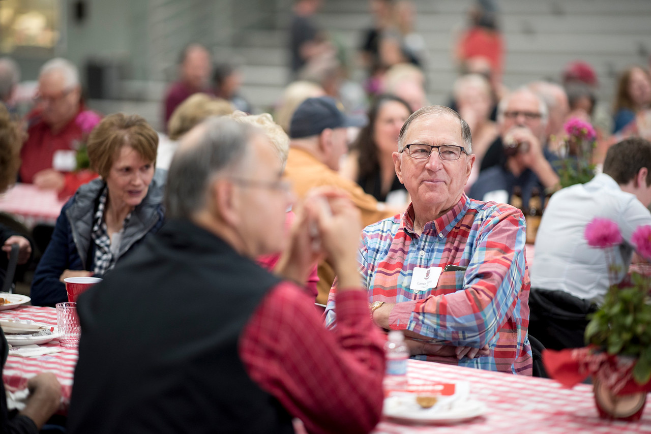 Lance Tennis (center) enjoys the Alumni Spring Barbecue that is held at the University Farm on Thursday, April 27, 2017, in Chico, Calif.  (Jessica Bartlett/ Photographer)