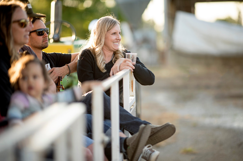 Guests enjoy a tour of the farm at the Alumni Spring Barbecue that is held at the University Farm on Thursday, April 27, 2017, in Chico, Calif.  (Jessica Bartlett/ Photographer)