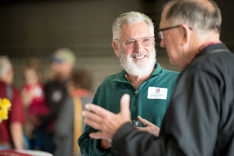 Anthony Edler (left) enjoys the Alumni Spring Barbecue that is held at the University Farm on Thursday, April 27, 2017, in Chico, Calif.  (Jessica Bartlett/ Photographer)