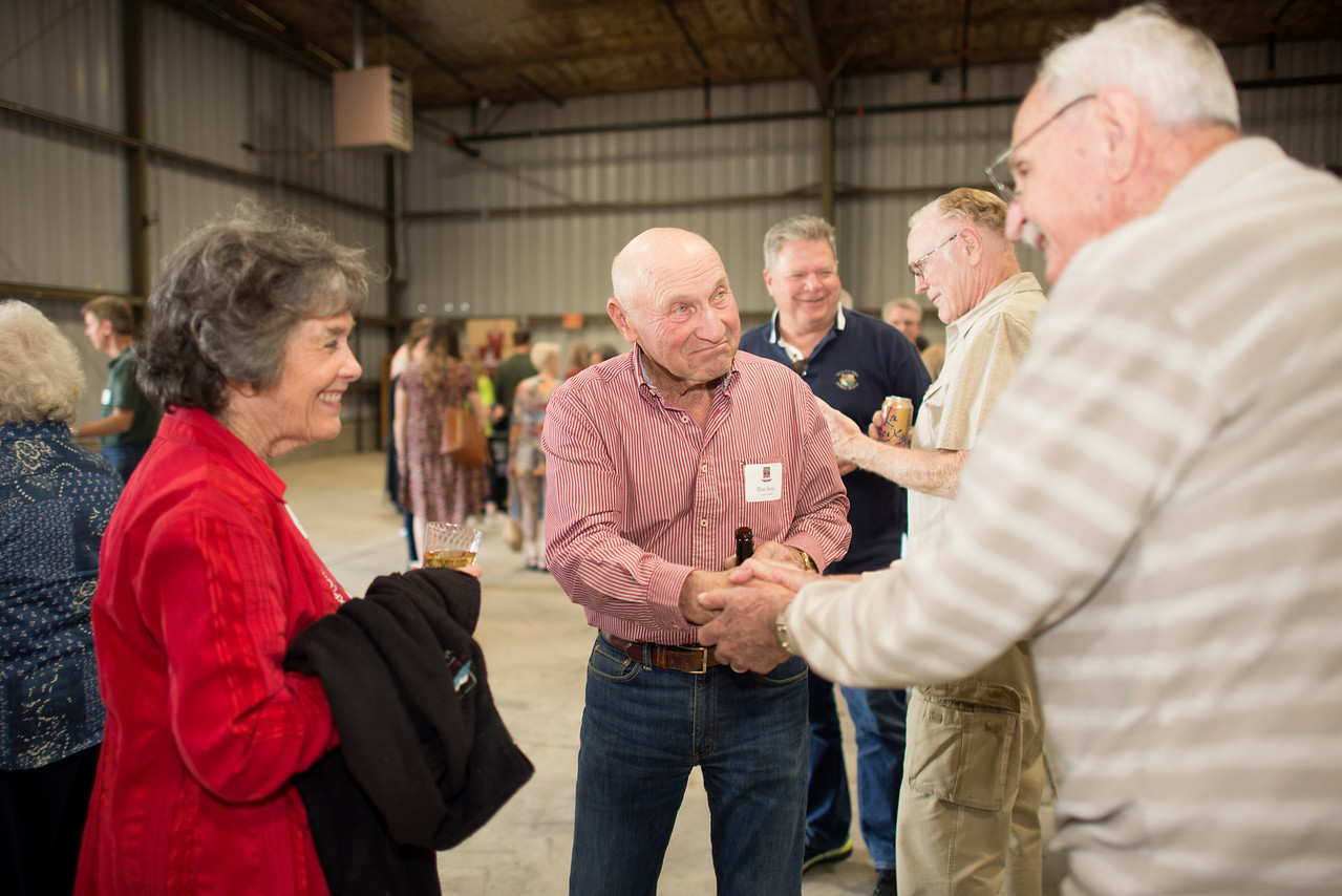 (from left to right) Nancy Hawley, Don Simic, and Ben Matthews, enjoy a conversation at the Alumni Spring Barbecue that is held at the University Farm on Thursday, April 27, 2017, in Chico, Calif.  (Jessica Bartlett/ Photographer)