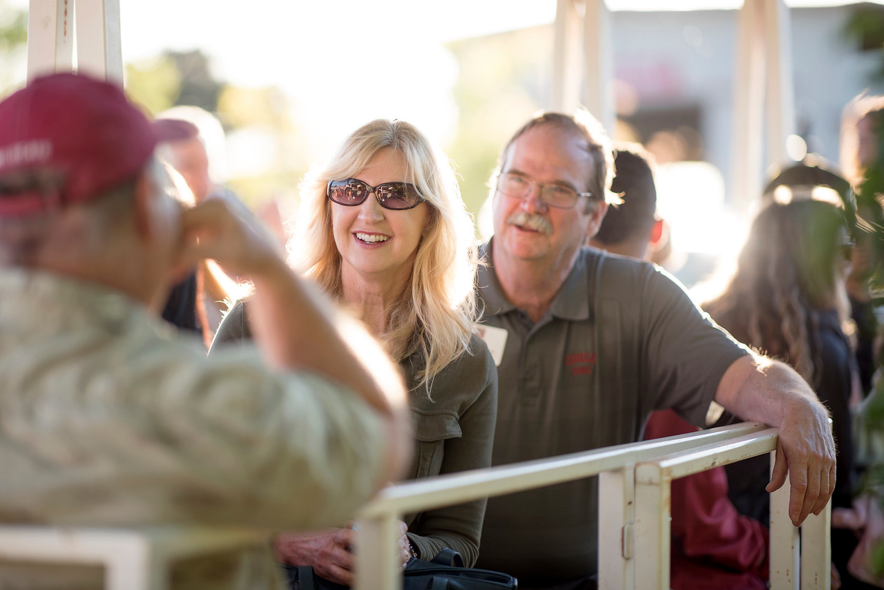 Richard O'Sullivan (right) enjoys a tour of the farm at the Alumni Spring Barbecue that is held at the University Farm on Thursday, April 27, 2017, in Chico, Calif.  (Jessica Bartlett/ Photographer)