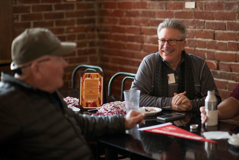 Rick Anderson (right) enjoys the Alumni Association Basketball Reception at Broadway Heights on Saturday, January 28, 2017. <br /> (Jessica Bartlett/ Student Photographer)