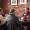 Chico State alum Tim Colbie, class of '92 (right) enjoys a conversation at a basketball Alumni Association reception that is held at Broadway Heights on Saturday, January 28, 2017. <br /> (Jessica Bartlett/ Student Photographer)