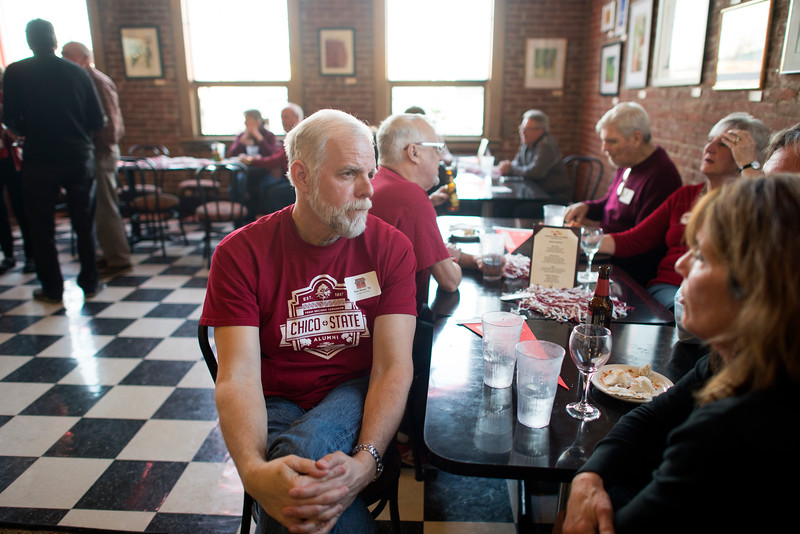 Chico State Alum Dan Hunt, class of '76, (left) enjoys a conversation at the Alumni Association Basketball Reception at Broadway Heights on Saturday, January 28, 2017. <br /> (Jessica Bartlett/ Student Photographer)
