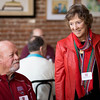 Alumni Ron Griffin, class of '67, (left) and Marilee Meuter, class of '81, (right) enjoy a conversation at the Alumni Association Basketball Reception at Broadway Heights on Saturday, January 28, 2017. <br /> (Jessica Bartlett/ Student Photographer)