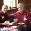 Chico State alumni Sandy Griffen, class of '66 (left) and Ron Griffen, class of '67 (right) enjoy a basketball Alumni Association reception that is held at Broadway Heights on Saturday, January 28, 2017. <br /> (Jessica Bartlett/ Student Photographer)