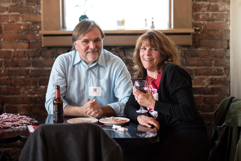 Chico State alum Steve Ferreira, class of '78 (left) smiles with Jill Ghirardelli (right) at a basketball Alumni Association reception that is held at Broadway Heights on Saturday, January 28, 2017. <br /> (Jessica Bartlett/ Student Photographer)