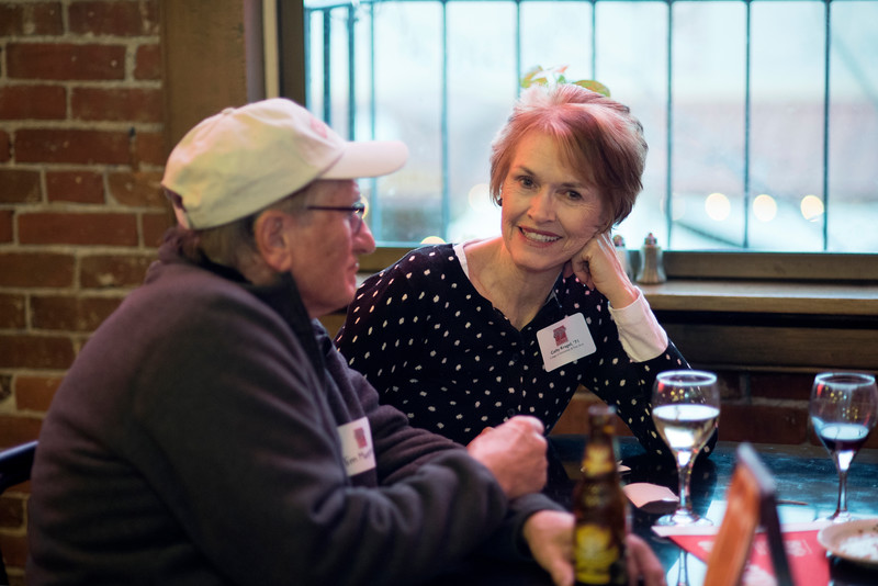 Chico State Alum Cathy Kragel, class of '71, (right) enjoys a conversation at the Alumni Association Basketball Reception at Broadway Heights on Saturday, January 28, 2017. <br /> (Jessica Bartlett/ Student Photographer)