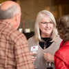 Deborah Mullins (center) enjoys a conversation at the Alumni Association Basketball Reception at Broadway Heights on Saturday, January 28, 2017. <br /> (Jessica Bartlett/ Student Photographer)
