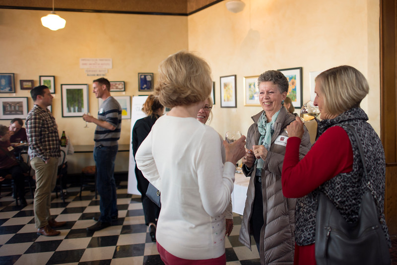 Guests enjoy conversation at the Alumni Association Basketball Reception at Broadway Heights on Saturday, January 28, 2017. <br /> (Jessica Bartlett/ Student Photographer)