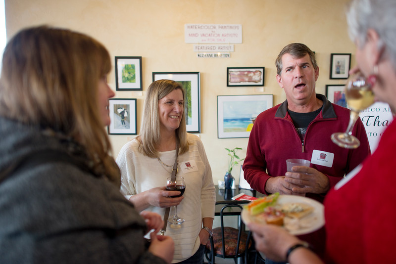 Alumn Heather Korff, class of '92, (left) and Brian Marshall (right) enjoy a conversation with fellow guests at the Alumni Association Basketball Reception at Broadway Heights on Saturday, January 28, 2017. <br /> (Jessica Bartlett/ Student Photographer)