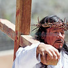 Ralph Chavez, from Bernalillo, portrays Jesus during the stations of the cross at the Santuario de Chimayo on Thursday, April 13, 2017. Parishioners with Our Lady of Sorrows youth group, from bernalillo, put on the re-enactment for pilgrims outside the Santuario. Luis Sánchez Saturno/The New Mexican