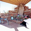Jared Justin Olivas Martinez, 21, from Chimayo, prays at one of the altars at the Santuario de Chimayo with his lowrider bicycle next to him after his annual pilgrimage to the Santuario de Chimayo on Thursday, April 13, 2017. Luis Sánchez Saturno/The New Mexican
