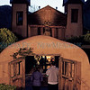 Maria Zamora, from Albuquerque, and her nephew, Michael Zamora, from Albuquerque, walk into the Santuario de Chimayo on Friday, April 14, 2017, during the annual Easter pilgrimage to the holy site. Luis Sánchez Saturno/The New Mexican