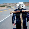 """Tino Edwell, cq, from Albuquerque, carries a 10 lbs cross on his way to the Santuario during the annual pilgrimage to the Santuario de Chimayo on Thursday, April 13, 2017. """"I do it because my father used to do it, and when he passed I took over the tradition for him."""" Edwell said. Luis Sánchez Saturno/The New Mexican"""