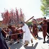 Alex Talavera, 16, left, from Bernalillo, and Carlo Lopez, 15, cq, right, as guards, whip Ralph Chavez, center, from Bernalillo, as he portrays Jesus during the stations of the cross at the Santuario de Chimayo on Thursday, April 13, 2017. Parishioners with Our Lady of Sorrows youth group, from bernalillo, put on the re-enactment for pilgrims outside the Santuario. Luis Sánchez Saturno/The New Mexican