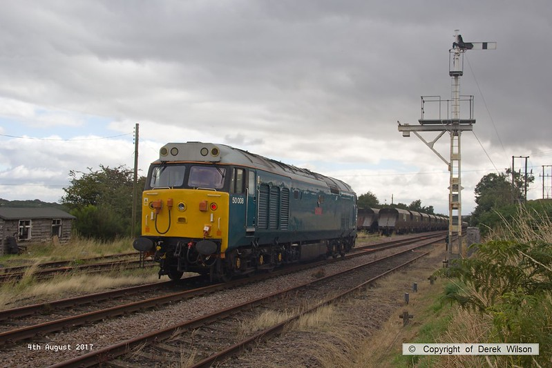 170804-007  Class 50 No 50008 Thunderer, on hire to DCR is captured pulling away from Thoresby as 0Z01, 08:03 Derby RTC - Thoresby Colliery Junction.  The loco was built for BR by English Electric & entered traffic in March 1968 as D408, so is almost 50 years old and is making the first appearance for the class on the former LD&ECR!! It is heading to Tuxford to collect a Loram Rail Grinder & take it to Derby.