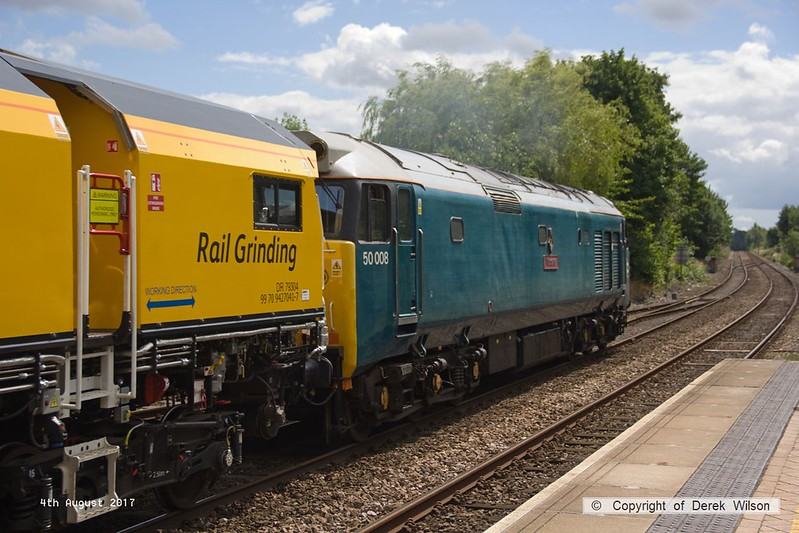170804-019  English Electric class 50 No 50008 Thunder is captured passing through Mansfield Woodhouse with 4Z01, 12:10 Thoresby Colliery Junction - Derby RTC. In tow is Loram Corrective Rail Grinder CRG1 (DR79301 - 304) which is heading back to Loram at Derby, then on to Carlisle. This left Thoresby early & was held for 'right time' at Warsop Junction which gave me time to get in front of it again!.