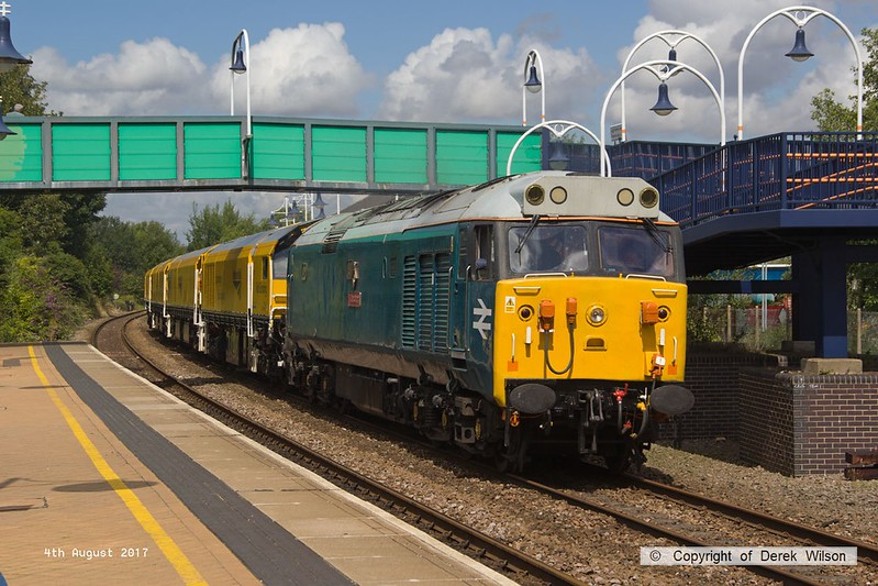 170804-017  English Electric class 50 No 50008 Thunder is captured passing through Mansfield Woodhouse with 4Z01, 12:10 Thoresby Colliery Junction - Derby RTC. In tow is Loram Corrective Rail Grinder CRG1 (DR79301 - 304) which is heading back to Loram at Derby, then on to Carlisle. This left Thoresby early & was held for 'right time' at Warsop Junction which gave me time to get in front of it again!.