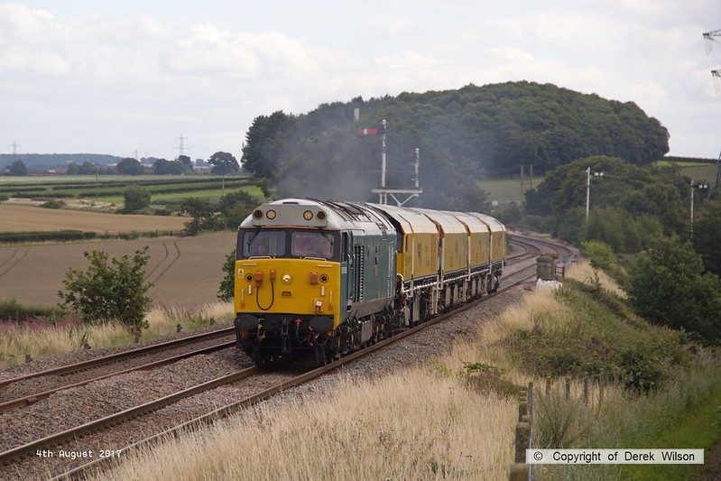 170804-009  English Electric class 50 No 50008 Thunder is captured passing the former Clipstone Junctions with 4Z01, 12:10 Thoresby Colliery Junction - Derby RTC. In tow is Loram Corrective Rail Grinder CRG1 (DR79301 - 304) which is heading back to Loram at Derby, then on to Carlisle.