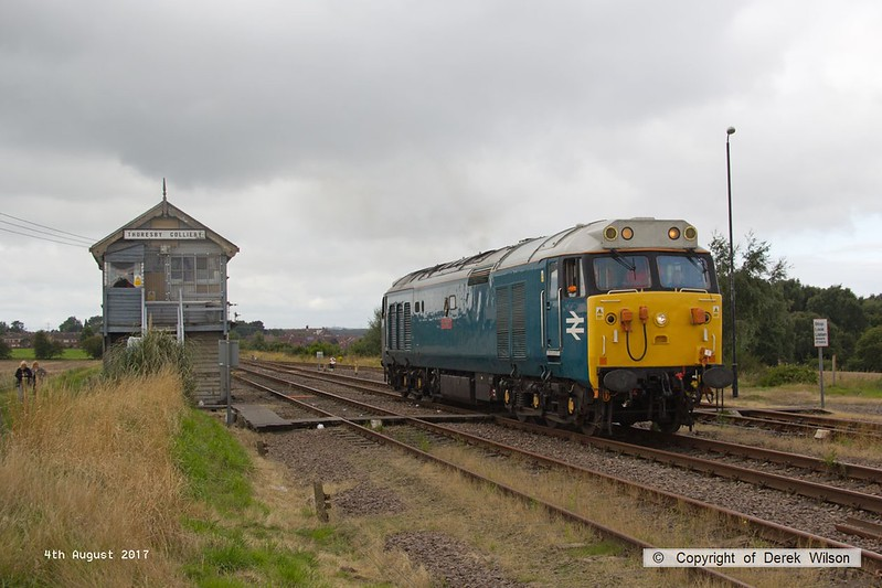 170804-006  Class 50 No 50008 Thunderer, on hire to DCR is captured pulling away from Thoresby as 0Z01, 08:03 Derby RTC - Thoresby Colliery Junction.  The loco was built for BR by English Electric & entered traffic in March 1968 as D408, so is almost 50 years old and is making the first appearance for the class on the former LD&ECR!! It is heading to Tuxford to collect a Loram Rail Grinder & take it to Derby.