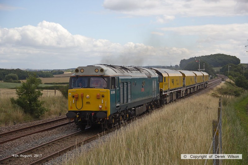 170804-014  English Electric class 50 No 50008 Thunder is captured passing the former Clipstone Junctions with 4Z01, 12:10 Thoresby Colliery Junction - Derby RTC. In tow is Loram Corrective Rail Grinder CRG1 (DR79301 - 304) which is heading back to Loram at Derby, then on to Carlisle.