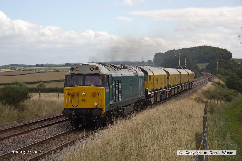 170804-013  English Electric class 50 No 50008 Thunder is captured passing the former Clipstone Junctions with 4Z01, 12:10 Thoresby Colliery Junction - Derby RTC. In tow is Loram Corrective Rail Grinder CRG1 (DR79301 - 304) which is heading back to Loram at Derby, then on to Carlisle.