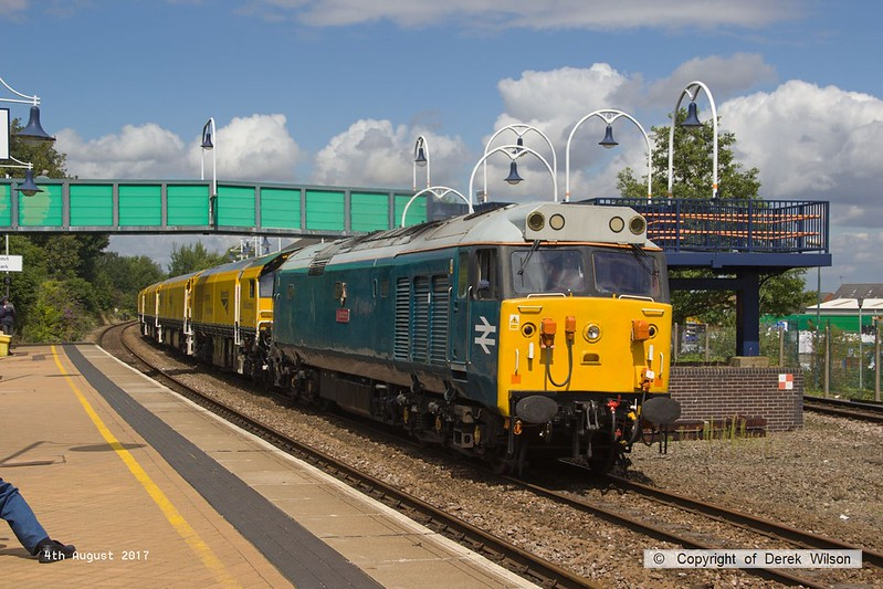 170804-018  English Electric class 50 No 50008 Thunder is captured passing through Mansfield Woodhouse with 4Z01, 12:10 Thoresby Colliery Junction - Derby RTC. In tow is Loram Corrective Rail Grinder CRG1 (DR79301 - 304) which is heading back to Loram at Derby, then on to Carlisle. This left Thoresby early & was held for 'right time' at Warsop Junction which gave me time to get in front of it again!.
