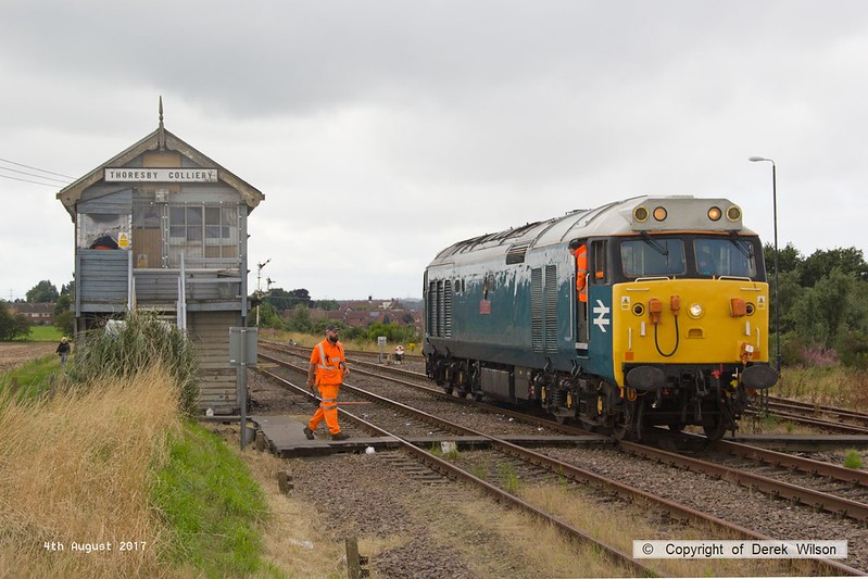 170804-005  Class 50 No 50008 Thunderer, on hire to DCR is captured arriving at Thoresby as 0Z01, 08:03 Derby RTC - Thoresby Colliery Junction.  The loco was built for BR by English Electric & entered traffic in March 1968 as D408, so is almost 50 years old and is making the first appearance for the class on the former LD&ECR!! It is heading to Tuxford to collect a Loram Rail Grinder & take it to Derby.