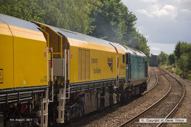 170804-020  English Electric class 50 No 50008 Thunder is captured passing through Mansfield Woodhouse with 4Z01, 12:10 Thoresby Colliery Junction - Derby RTC. In tow is Loram Corrective Rail Grinder CRG1 (DR79301 - 304) which is heading back to Loram at Derby, then on to Carlisle. This left Thoresby early & was held for 'right time' at Warsop Junction which gave me time to get in front of it again!.