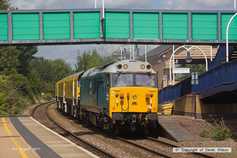 170804-015  English Electric class 50 No 50008 Thunder is captured passing through Mansfield Woodhouse with 4Z01, 12:10 Thoresby Colliery Junction - Derby RTC. In tow is Loram Corrective Rail Grinder CRG1 (DR79301 - 304) which is heading back to Loram at Derby, then on to Carlisle. This left Thoresby early & was held for 'right time' at Warsop Junction which gave me time to get in front of it again!.