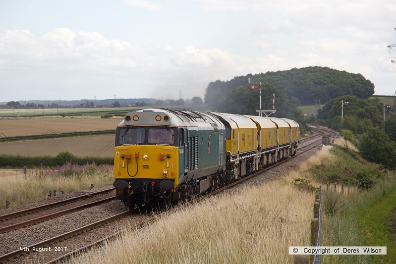 170804-011  English Electric class 50 No 50008 Thunder is captured passing the former Clipstone Junctions with 4Z01, 12:10 Thoresby Colliery Junction - Derby RTC. In tow is Loram Corrective Rail Grinder CRG1 (DR79301 - 304) which is heading back to Loram at Derby, then on to Carlisle.