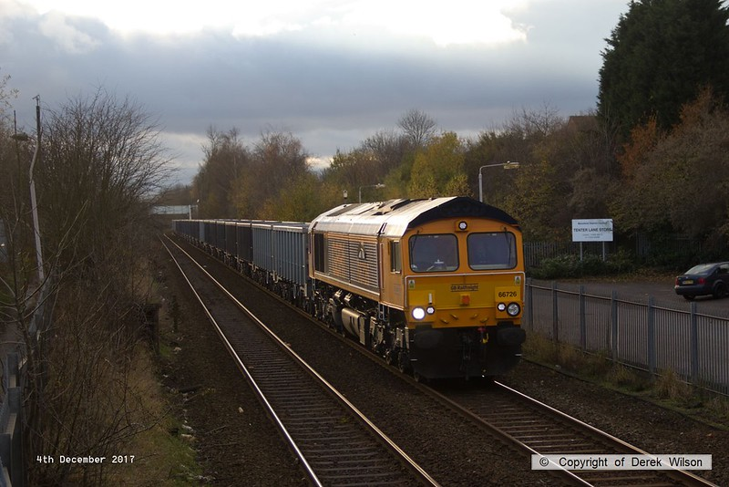 171204-001  A small timely break in the cloud lit this up nicely, GB Railfreight class 66/7 No 66726 Sheffield Wednesday is captured passing Tenter Lane, Mansfield, powering train 6E89, 10:20 Wellingborough up TC - Rylstone, empty JNA bogie box wagons.