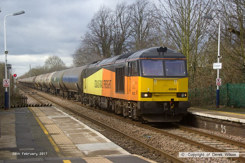 170228-002  Colas Rail Freight class 60 No 60026 passes Bingham with 6E82, 12:16 Rectory Junction - Lindsey oil refinery empty (fuel oil) bogie tanks.