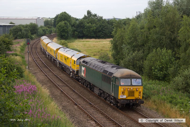 170710-003 DCR class 56 No 56303 is seen passing Sutton-In-Ashfield on the Robin Hood Line, hauling Loram Corrective Rail Grinder CRG1 (DR79301 - 304) running as 4Z01, 08:00 Chaddesden sidings, Derby - Thoresby Colliery Junction. The Rail grinder was being returned to the High Marnham Test Track to continue commissioning trials, after paying a visit to the Dartmoor Railway.