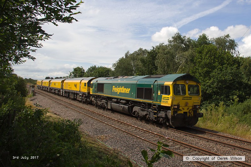 170703-001  On Monday 3rd July 2017 Freightliner class 66/5 No 66520 returned Loram Corrective Rail Grinder CRG2 (DR 79401 - 404) to Tuxford to continue commissioning trials. Running as 6Z43, 12:10 Drax AES - Thoresby Colliery Junction it is captured passing the site of the long gone Clipstone sidings, on the former Lancashire Derbyshire & East Coast Railway.