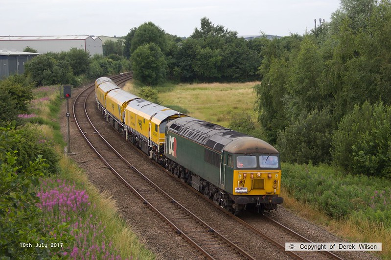 170710-001 DCR class 56 No 56303 is seen passing Sutton-In-Ashfield on the Robin Hood Line, hauling Loram Corrective Rail Grinder CRG1 (DR79301 - 304) running as 4Z01, 08:00 Chaddesden sidings, Derby - Thoresby Colliery Junction. The Rail grinder was being returned to the High Marnham Test Track to continue commissioning trials, after paying a visit to the Dartmoor Railway.