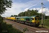 170703-003  On Monday 3rd July 2017 Freightliner class 66/5 No 66520 returned Loram Corrective Rail Grinder CRG2 (DR 79401 - 404) to Tuxford to continue commissioning trials. Running as 6Z43, 12:10 Drax AES - Thoresby Colliery Junction it is captured passing the site of the long gone Clipstone sidings, on the former Lancashire Derbyshire & East Coast Railway.