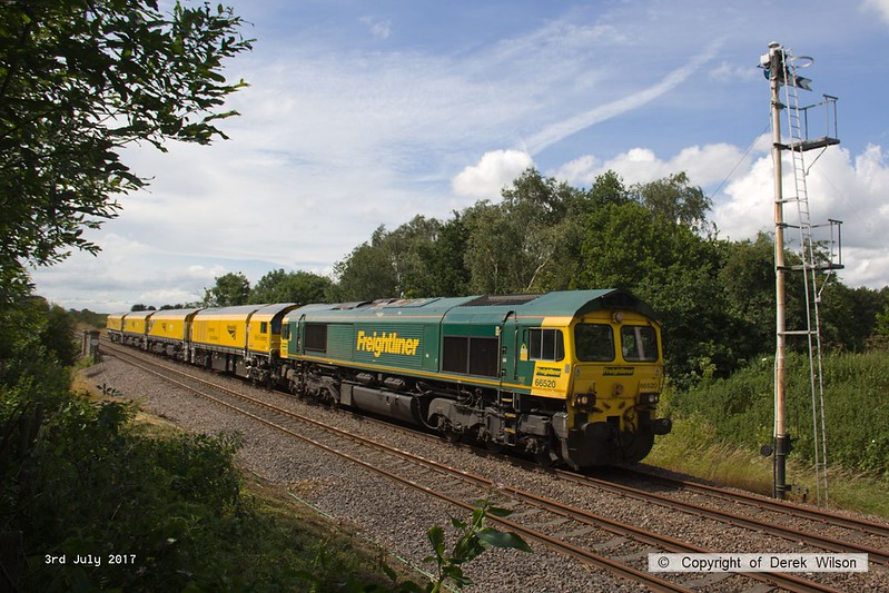 170703-002  On Monday 3rd July 2017 Freightliner class 66/5 No 66520 returned Loram Corrective Rail Grinder CRG2 (DR 79401 - 404) to Tuxford to continue commissioning trials. Running as 6Z43, 12:10 Drax AES - Thoresby Colliery Junction it is captured passing the site of the long gone Clipstone sidings, on the former Lancashire Derbyshire & East Coast Railway.