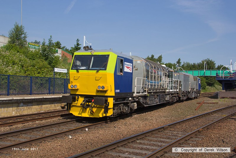 170619-002  Network Rail's annual weedkilling train is seen passing through Mansfield Woodhouse on the Robin Hood Line, formed by Windhoff MPV's No's DR98910 & DR98960.