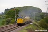 170519-006  Network Rail class 97 No 97301 is captured on the LDECR passing Clipstone West, powering train 4Z01, 16:00 Thoresby Colliery Junction - Chaddesden sidings 17:45. In tow is Loram Rail Grinder CRG1, DR79301 - 304 which is being taken to Bishop Auckland, via Derby. It is to stay up North for a week and then be returned to Tuxford.