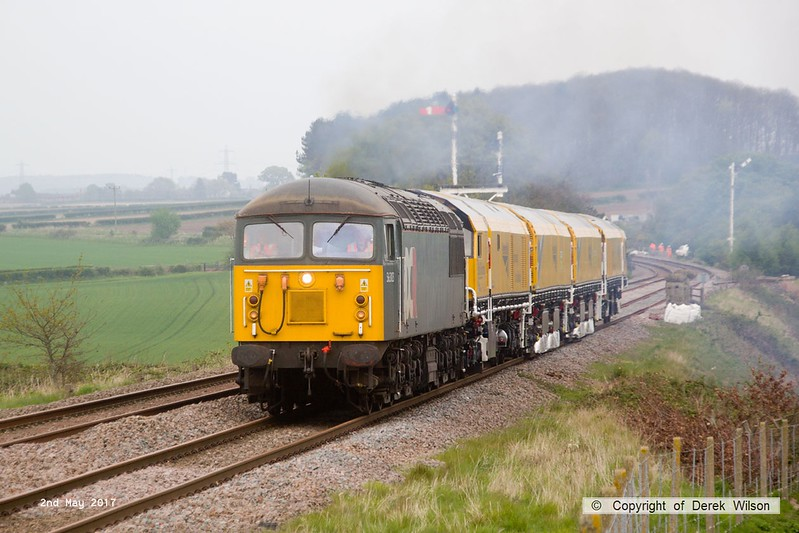 170502-019  Problem seems to be sorted & 56303 is now moving normally with the Rail Grinder in tow, train 8Z01, 21:00 Thoresby Colliery Junction - Derby RTC. Captured passing Clipstone West still 210 minutes early!! The response team that attended the troubled train can be seen in the distance.