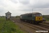 170502-007  DCR class 56 No 56303 pulls away from Thoresby colliery junction, heading to Tuxford to collect Loram Rail Grinder CRG2 which has severe wheel flats.
