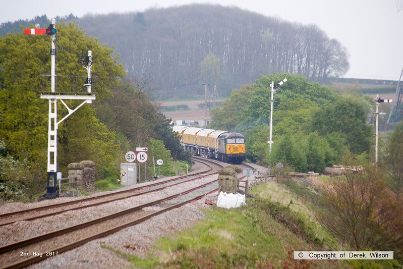 170502-014  Problem seems to be sorted & 56303 is now moving normally with the Rail Grinder in tow, train 8Z01, 21:00 Thoresby Colliery Junction - Derby RTC. Captured passing Clipstone West still 210 minutes early!!