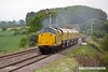 170519-007  Network Rail class 97 No 97301 is captured on the LDECR passing Clipstone West, powering train 4Z01, 16:00 Thoresby Colliery Junction - Chaddesden sidings 17:45. In tow is Loram Rail Grinder CRG1, DR79301 - 304 which is being taken to Bishop Auckland, via Derby. It is to stay up North for a week and then be returned to Tuxford.