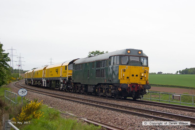 170515-006  DCR class 31 No 31452 is seen approaching the former Clipstone East Junction under caution, returning Loram Rail Grinder CRG2 (DR79401, DR79402, DR79403 & DR79404) to Tuxford, running as 4Z01, 04:32 Derby RTC - Thoresby Colliery Junction. Due to vandalism the semaphore signals were unable to be pulled off, vandalism has become an ongoing problem on the branch since the closure of Thoresby Colliery, with the boxes only manned as and when required. Monday 15th May 2017.